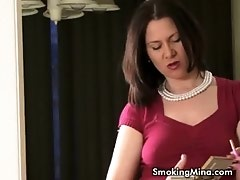 Sexy smoker MILF talks while smoking