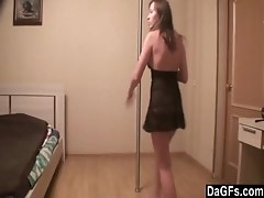 Angela strips and pole dances
